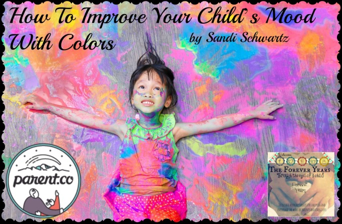 little girl covered in colorful paint